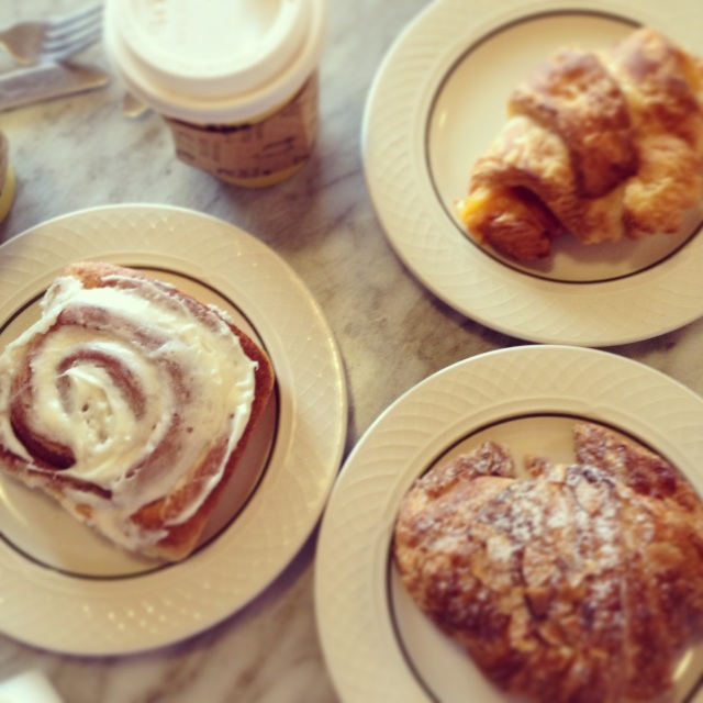 Clockwise from left: cinnamon roll - ham and cheese croissant - almond croissant